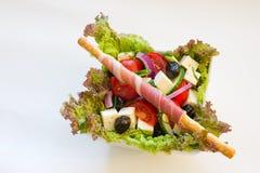 Salad and prosciutto Stock Photos