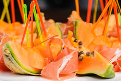 Salad with prosciutto and papaya Stock Photography