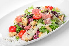 Salad with prosciutto, parmigiano, tomato and ruccola Stock Image
