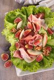 Salad with prosciuttol and fig Royalty Free Stock Photos