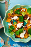 Salad with pumpkin, lime and tahini Stock Images