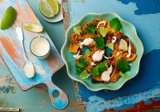 Salad with pumpkin, lime and tahini Stock Photos