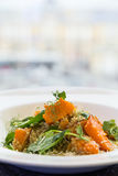 Salad with pumpkin, seeds and pea on bakground of light window i Stock Photos
