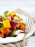 Salad with pumpkin and sesame seeds Royalty Free Stock Photo
