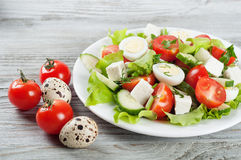 Salad with quail eggs and cherry tomato Royalty Free Stock Photography