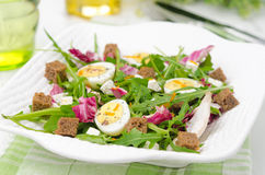 Salad with quail eggs, feta and arugula, horizontal Royalty Free Stock Images