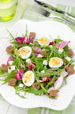 Salad with quail eggs, feta and arugula, top view Stock Photos