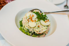 Salad with quail eggs, greens and red caviar Stock Images