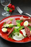 Salad with quail eggs and salami Royalty Free Stock Photo