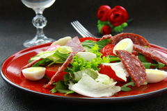 Salad with quail eggs and salami Stock Photos