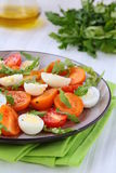 Salad with quail eggs and tomato Royalty Free Stock Photo