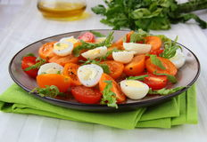 Salad with quail eggs and tomato Royalty Free Stock Photos