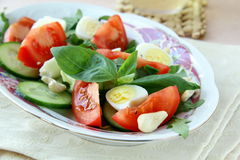 Salad with quail eggs and tomato Stock Images