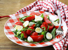 Salad with quail eggs and  tomatoes Stock Photography