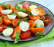 Salad with quail eggs and  tomatoes Stock Images