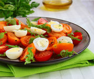 Salad with quail eggs and  tomatoes Royalty Free Stock Photo