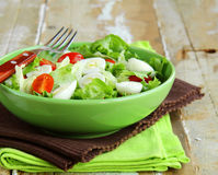 Salad with quail eggs and  tomatoes Royalty Free Stock Images