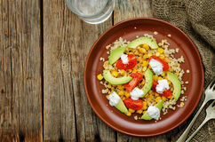 Salad with quinoa, red lentils, corn, avocado and tomato with yo. Gurt sauce. tinting. selective focus Royalty Free Stock Images