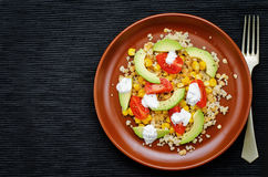 Salad with quinoa, red lentils, corn, avocado and tomato with yo. Gurt sauce. tinting. selective focus Stock Images