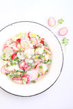 Salad with radish , green onion and egg. In a white plate. white background Royalty Free Stock Photography