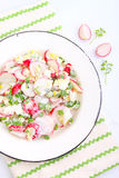 Salad with radish , green onion and egg. In a white plate. white background Stock Photo