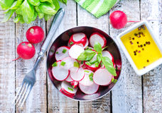 Salad with radish. In the metal bowl Stock Photos