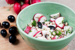 Salad with radishes and black olives Stock Photo