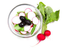 Salad radishes from. Salad radishes in bowl on white background from above Stock Image