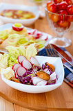 Salad with radishes and mussels Royalty Free Stock Images