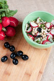 Salad with radishes, olives and beans Stock Photography