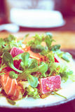 Salad with rare fried tuna and salmon, toned image Royalty Free Stock Photo