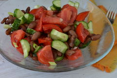 Salad with red beans. Tomato and cucumber salad with red beans Royalty Free Stock Photography