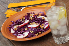 Salad with red cabbage, apples, and walnuts royalty free stock photos