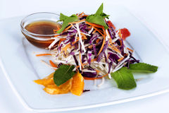 Salad with red cabbage, carrots, oranges and mint stock photos