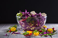 Salad with red cabbage, feta cheese, tomatoes cherry and chili pepper Stock Photos
