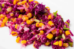 Salad of red cabbage, onion, yellow corn and apple Royalty Free Stock Photography