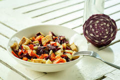 Salad with red cabbage on a white table Royalty Free Stock Photography
