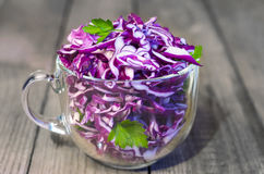 Salad of red cabbage. Wooden background, selective focus royalty free stock photo