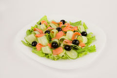 Salad with red fish and cucumbers. Clipping path included stock photo