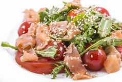 Salad of red fish with tomato and sesame Stock Photos