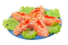 Salad with red salmon caviar - Sea star Royalty Free Stock Images