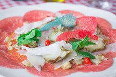 Salad with red tuna artichokes and mint leaves. Exclusive Italian recipe royalty free stock photography