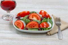 Salad and red wine for dinner Royalty Free Stock Photo