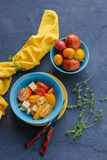 Salad of red and yellow tomatoes in a bowl stock photography