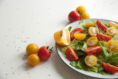 Salad with red and yellow tomatoes. Bright and fresh salad with red and yellow tomatoes Stock Photo