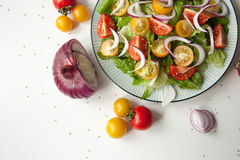 Salad with red and yellow tomatoes. Bright and fresh salad with red and yellow tomatoes royalty free stock photography