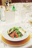 Salad on restaurant table, toned Stock Photography