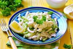 Salad from rice,calamari and fresh cucumber. Stock Photos