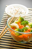 Salad, rice and chopsticks Royalty Free Stock Photography