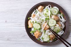 Salad of rice noodles with chicken and cucumbers top view Stock Photo